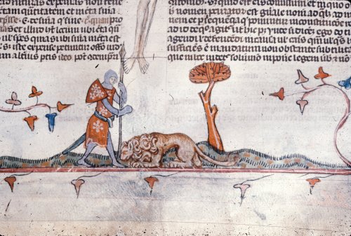 Lion crouching at knight's feet