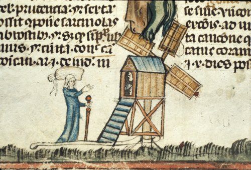 Woman approaching a windmill