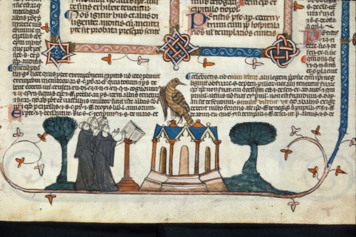 Four monks at a lecturn