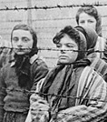 Image of girls behind barbed wire