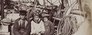 Hans Henri, Esquimaulx dog-driver, with his son and daughter, Proven, Greenland,