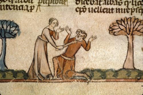 Woman hitting a man with a stick