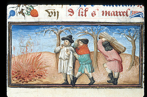 Men burning firewood