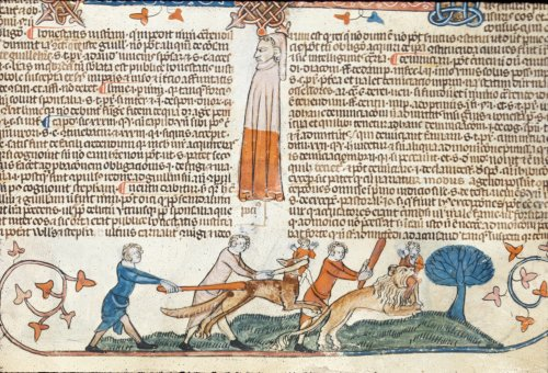 Men clubbing a wolf and a lion
