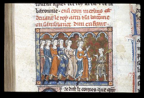 Merlin stands before King Arthur