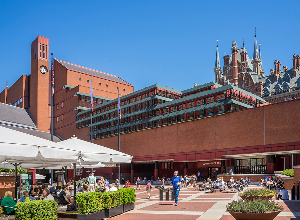 British Library with people on the piazza on a bright day.