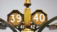 Brass numbers used to number and identify Library desks.