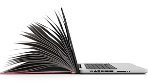 Composite photograph of a laptop with pages of a book.