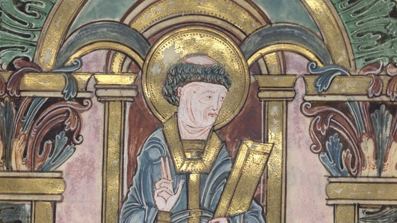 A portrait of St Swithun wearing golden episcopal vestments and holding a book, from the Benedictional of St Æthelwold.
