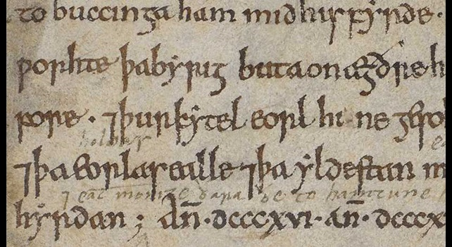 A detail from a manuscript of the Anglo-Saxon Chronicle, showing an entry written in Old English.