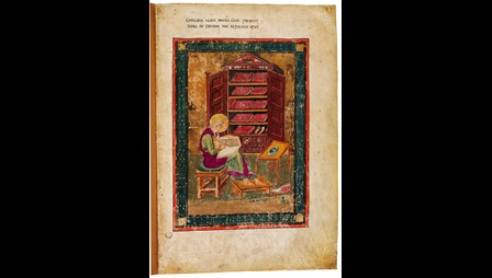 A full-page portrait of the Old Testament prophet Ezra writing in a book, from Codex Amiatinus.