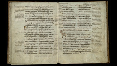 An opening from a 10th-century manuscript of Boethius' Consolation of Philosophy, featuring numerous marginal and interlinear glosses.