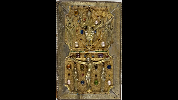 The treasure binding of the Judith of Flanders Gospels, made from silver-gilt and jewels. The figure of Christ in Majesty appears flanked by angels, above a scene of the Crucifixion.