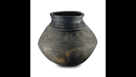 The Loveden Hill Urn, a 5th-century cremation urn featuring a runic inscription.