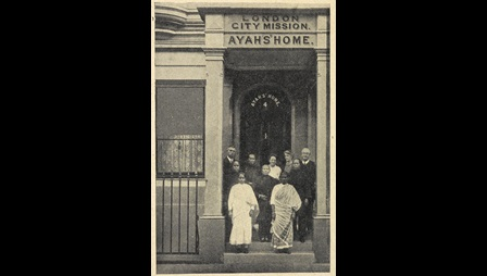 Photograph of a group, including South Asian women, stood outside the Ayahs Home in Hackney