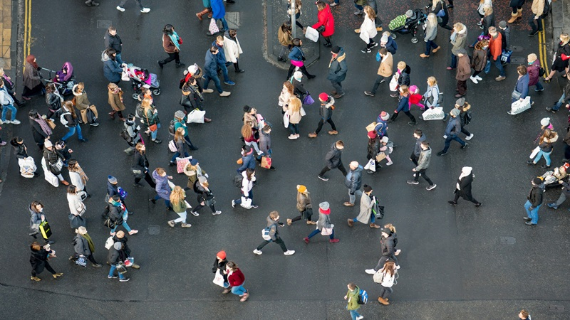 Photograph of a crowd of shoppers from above