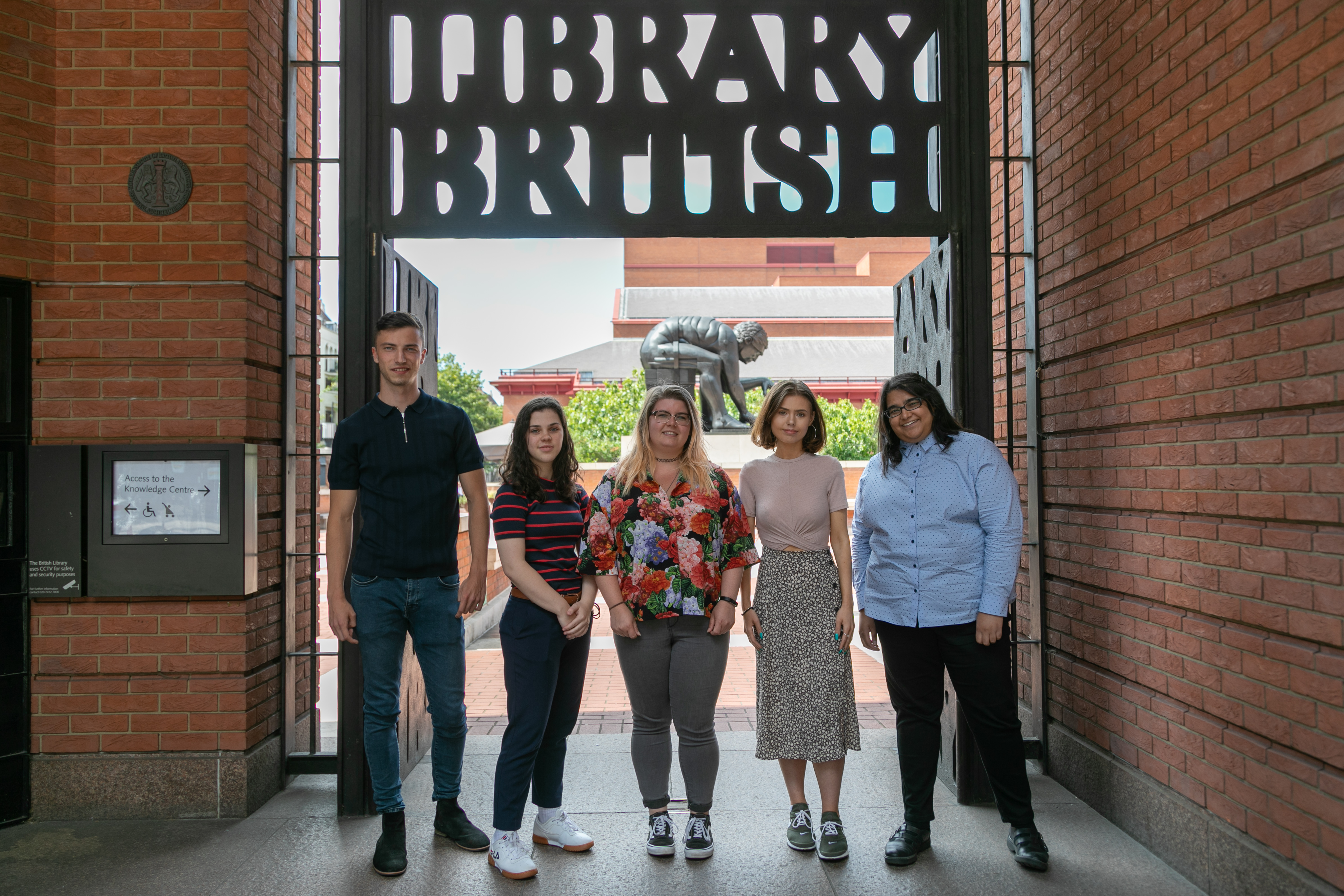 Apprentices standing outside the British Library building