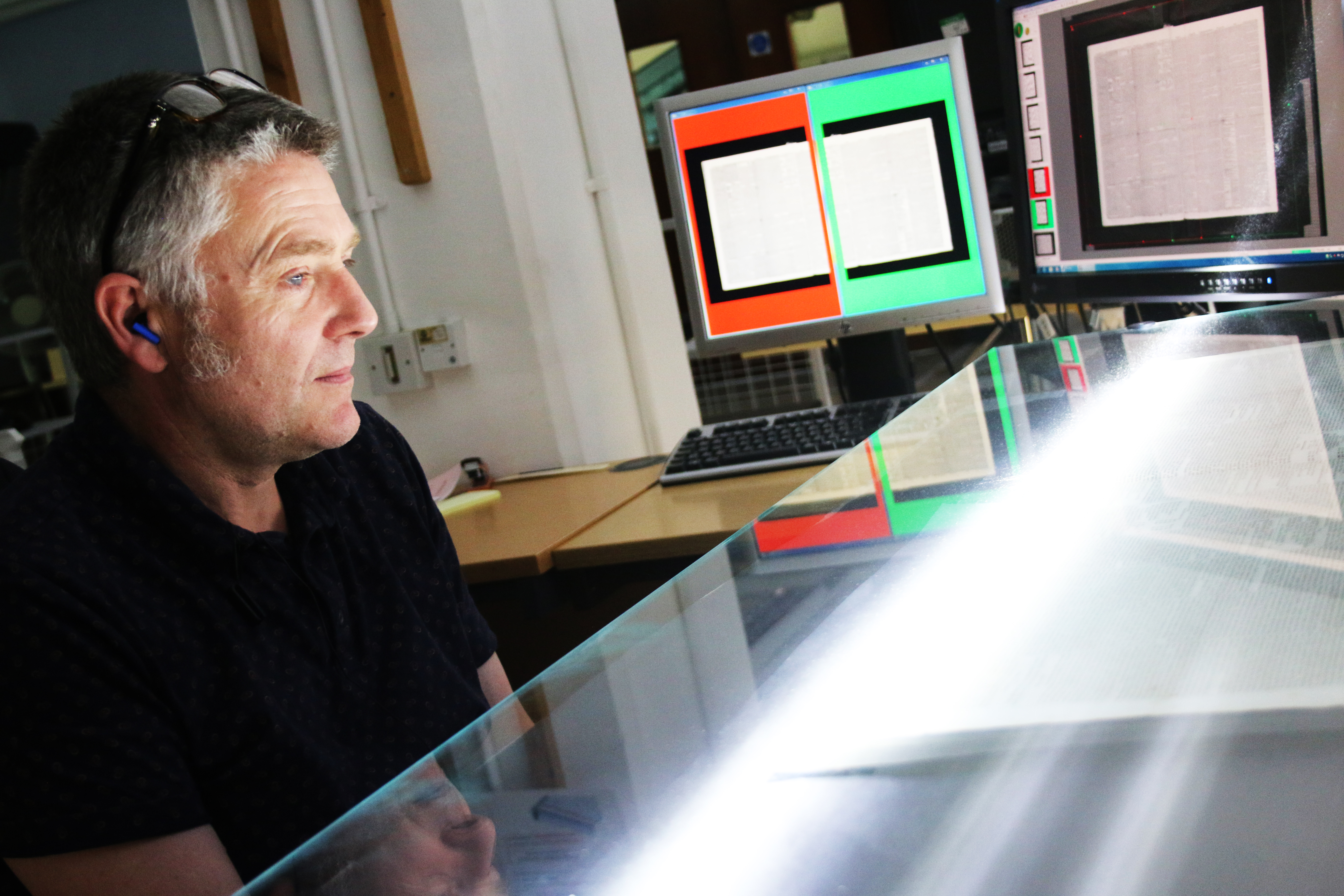 Imaging Services north team member working a large-scale scanner
