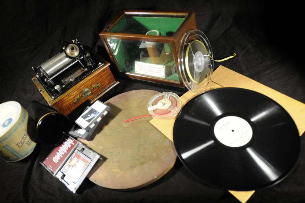 A selection of musical formats including CDs and vinyls