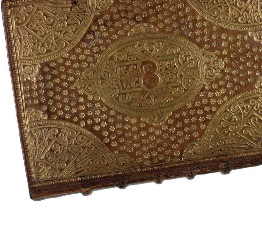 A bookbinding embossed with gold.