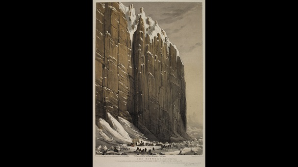 Two dozen men camping in the ice at the base of a very steep rock cliff.