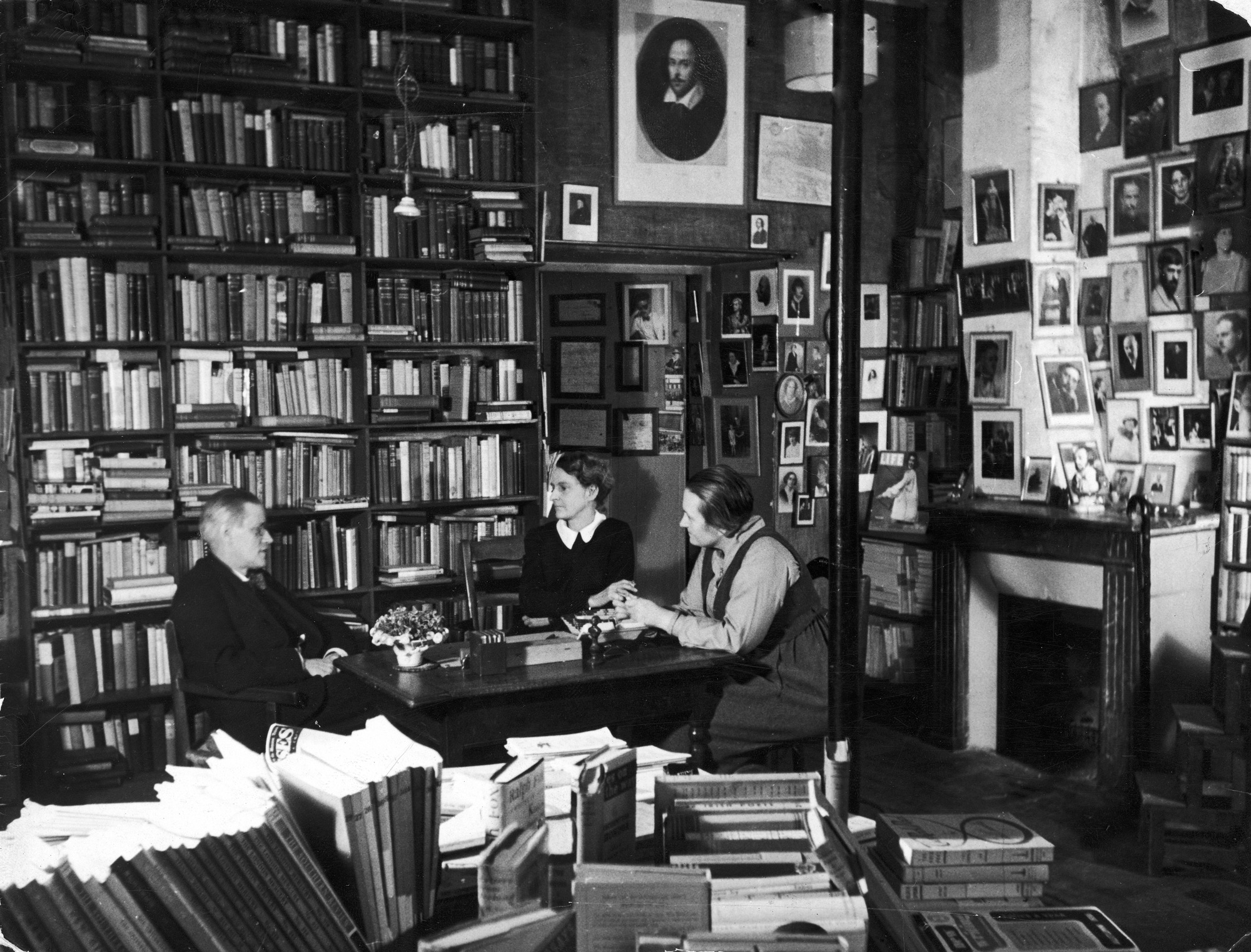 Photograph of James Joyce chatting with Shakespeare & Co. bookstore owner Sylvia Beach and Adrienne Monnier