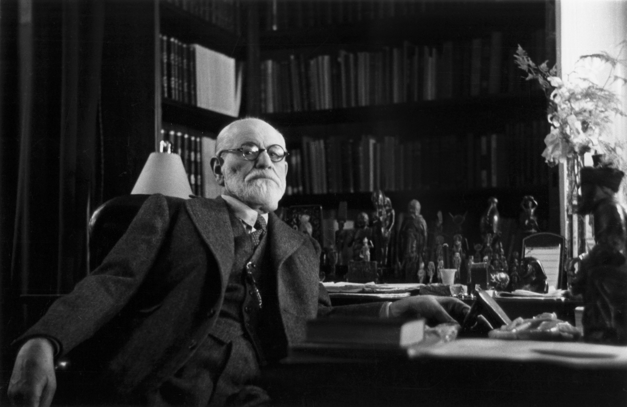Austrian psychoanalyst Sigmund Freud in his office in Vienna, circa 1937