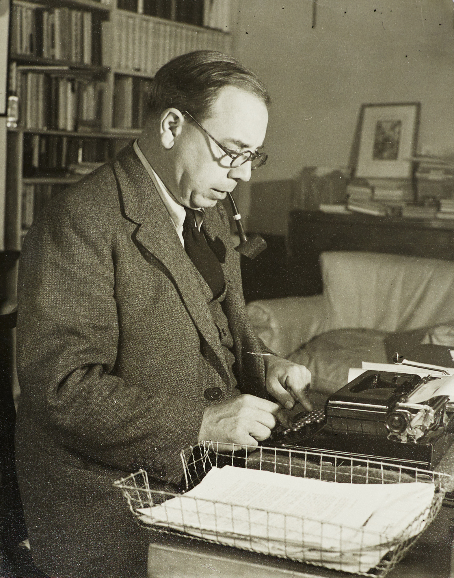 Photograph of J B Priestley at his typewriter
