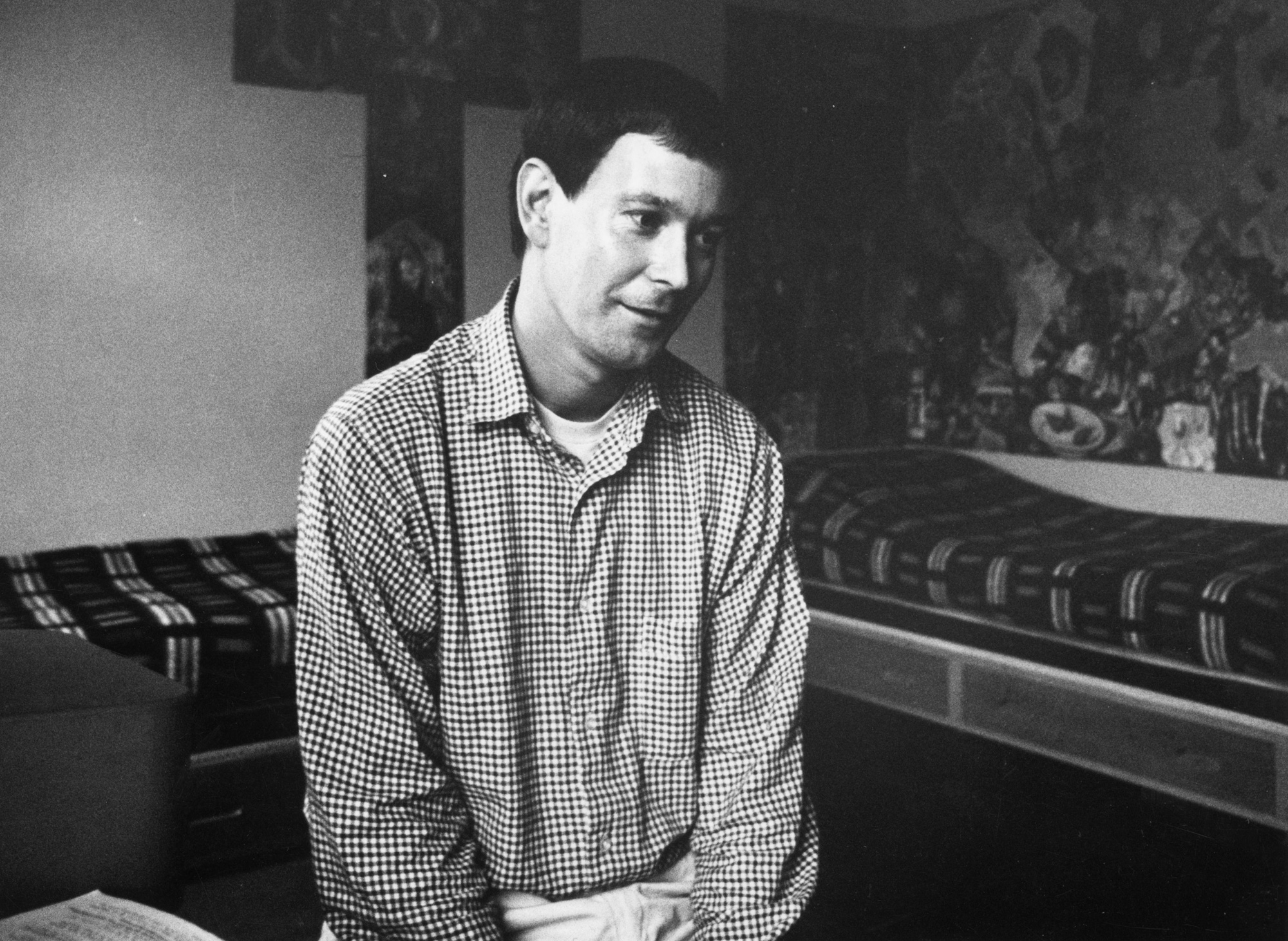 October 1966: British playwright Joe Orton at home in Islington, London. (Photo by Harry Thompson/Evening Standard/Getty Images)