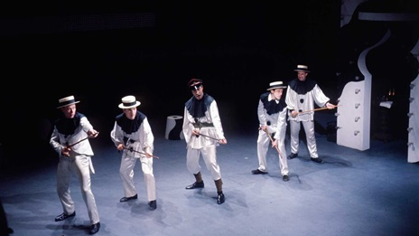 Photograph showing pierrot soldiers, appearing to hold canes like weapons, from a production of Oh What a Lovely War