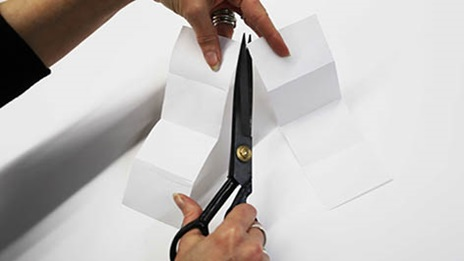 paper being cut by scissors