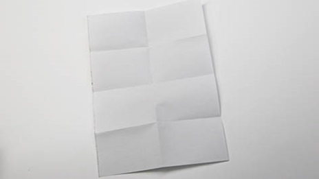 a piece of paper with folded crease lines