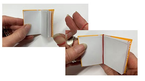 an elastic band being added to a mini book spine