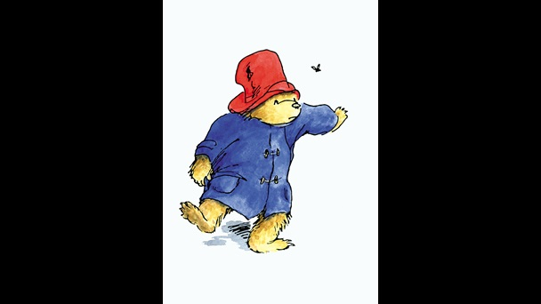 An illustration of Paddington Bear. He is wearing a read hat and blue duffle coat. He is walking towards a butterfly hovering just in front of his nose