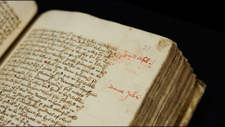Medieval manuscript with handwritten script and text in the margins