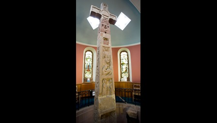 The Ruthwell Cross, an 8th-century stone cross carved with inscriptions in runic and Latin letters and scenes from the life of Christ, housed in Ruthwell church.