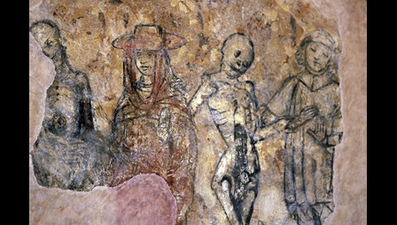 Fresco depicting a danse macabre with skeleton figures alongside the living