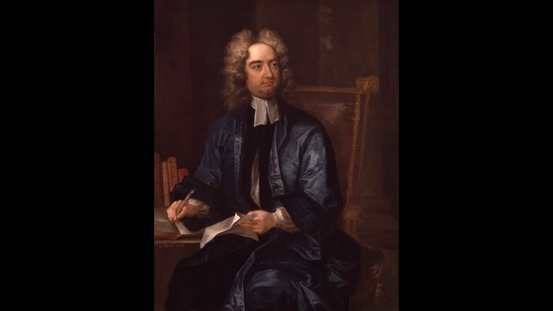 Painted portrait of Jonathan Swift, seated at a table with writing materials in his hands and wearing a long blue silk jacket and wig