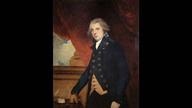 Painted portrait of Richard Brinsley Sheridan, in blue buttoned jacket and standing with his arm resting on a table