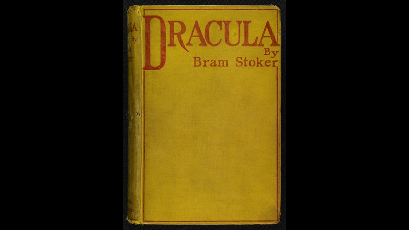 Yellow front cover printed with the text 'Dracula by Bram Stoker' in red