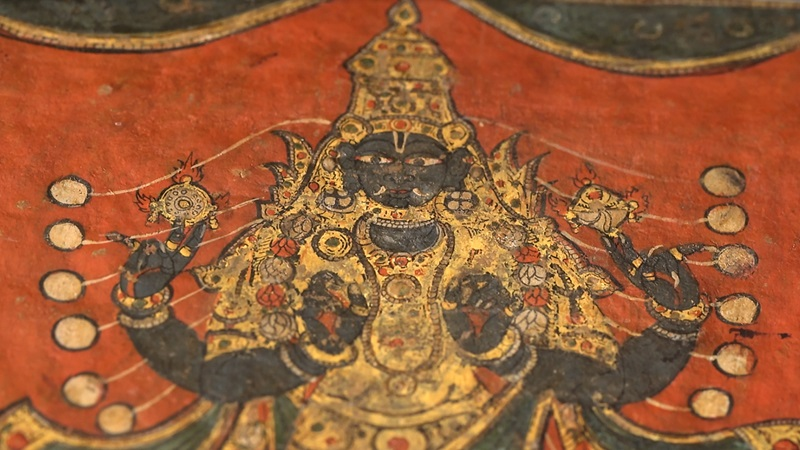 A close up image of the face of a Hindu Deity