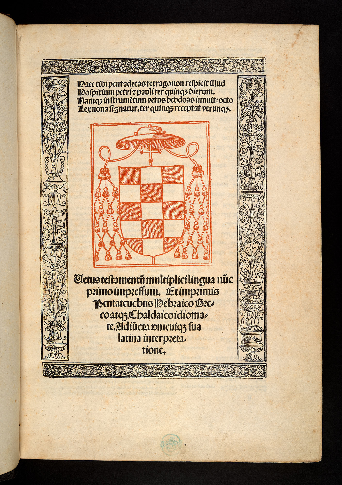 Title page of volume one of the so-called 'Complutensian Polyglot Bible'. There page features a coat-of-arms in red and floral border in black ink