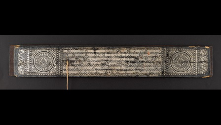 This manuscript is written in Pāli text on silvered palm leaves. The script is Burmese round script in black, and there are black lacquered decoration margins. The marginal and outer cover decorations on the manuscript show the earliest iconographic representations of the First Sermon, the Wheel of the Doctrine (Dhammacakka).