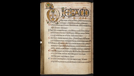 A page from the Vespasian Psalter, featuring decorated initials and glosses in Old English.