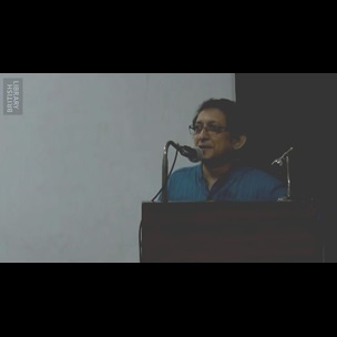 A still image from a video showing Abhijit Gupta, Professor of English at Jadavpur University standing at a lectern during his paper presentation 'Ramram Basu's letter of 10 February 1801'. This presentation was given as part of The Book Unbound conference, held at Jadavpur University on 14 and 15 July 2017.