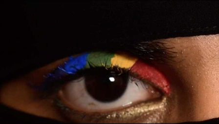 A pair of eyes decorated with a rainbow flag