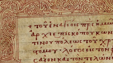A detail from a 12th-century homiliary, featuring a headpiece in red ink and the title of the text in red underneath.