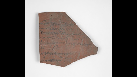 A potsherd inscribed with a receipt for a pasture tax, written in Ancient Greek.