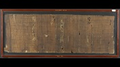 The first frame of the Harris Homer Roll, a dark brown papyrus roll, containing almost the entire Book XVIII of the Iliad, arranged in continuous columns.