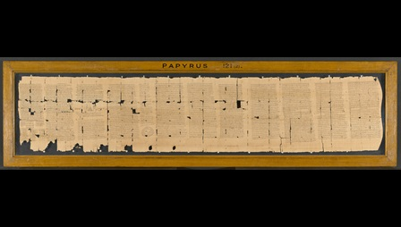 A 3rd-century papyrus roll containing a magical handbook, arranged in continuous columns.